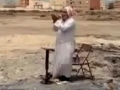 Old Man praying on the ruins of demolished mosque in Bahrain - All Languages