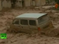 Mad Mud River: Dramatic video of cars swept away by China flood - 13Jul2011 - All Languages