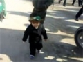 Youngest Shia Muslim girl walking towards Karbala - Arabic - All   language