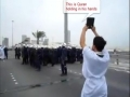 Bahrain Mercenaries shoot the Quran of a Brave Protesters Hands - All Languages