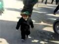 Youngest Shia Muslim girl walking towards Karbala - Arabic - All   language